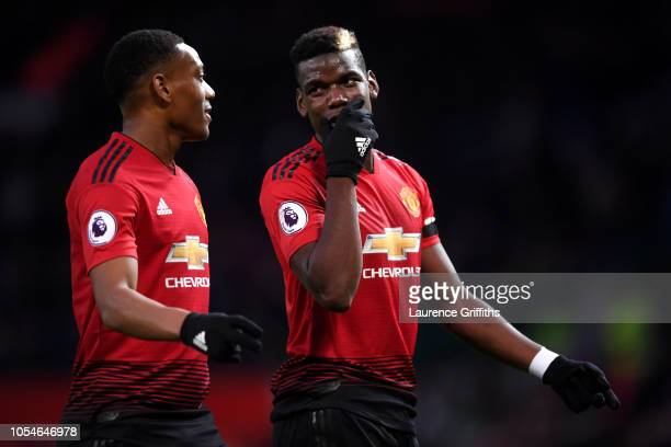 Paul Pogba and Anthony Martial of Manchester United talk during the Premier League match between Manchester United and Everton FC at Old Trafford on...