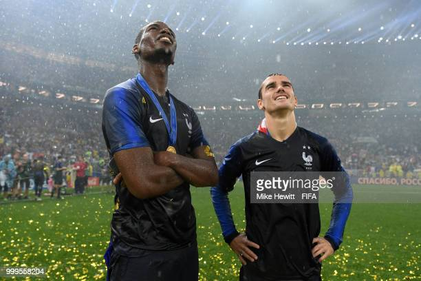Paul Pogba and Antoine Griezmann of France celebrate victory following the 2018 FIFA World Cup Final between France and Croatia at Luzhniki Stadium...