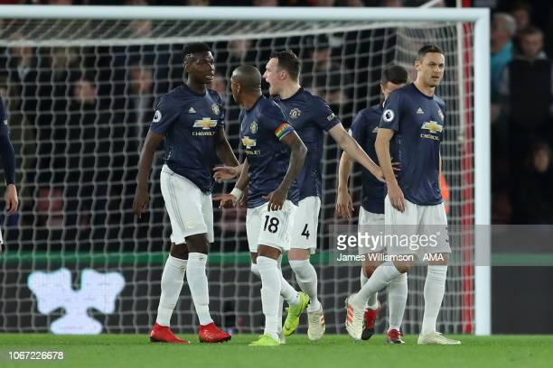 Paul Pogba and Ashley Young and Phil Jones of Manchester United in discussion after Cedric Soares of Southampton scores a goal to make it 20 during...