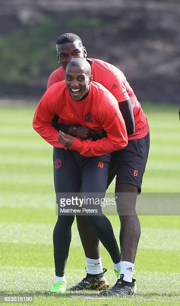 Paul Pogba and Ashley Young of Manchester United in action during a first team training session at Aon Training Complex on March 15, 2017 in...