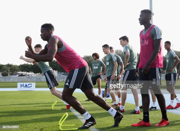 Paul Pogba and Axel Tuanzebe of Manchester United in action during a first team training session at Nad Sheba Sports Complex on January 9 2018 in...