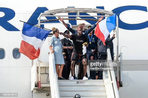 Paul Pogba and Benjamin Mendy of France during the arrival at Airport Roissy Charles de Gaulle on July 16 2018 in Paris France