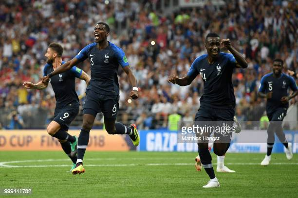 Paul Pogba and Blaise Matuidi of France celebrates after Mario Mandzukic of Croatia scores an own goal for France's first goal during the 2018 FIFA...