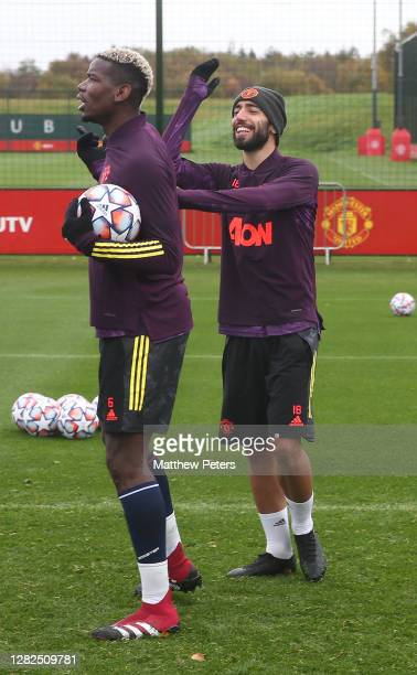 Paul Pogba and Bruno Fernandes of Manchester United in action during a first team training session ahead of the UEFA Champions League Group H stage...