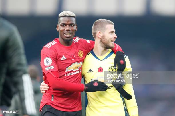 Paul Pogba and David De Gea of Manchester United celebrate following their team's victory in the Premier League match between Everton and Manchester...