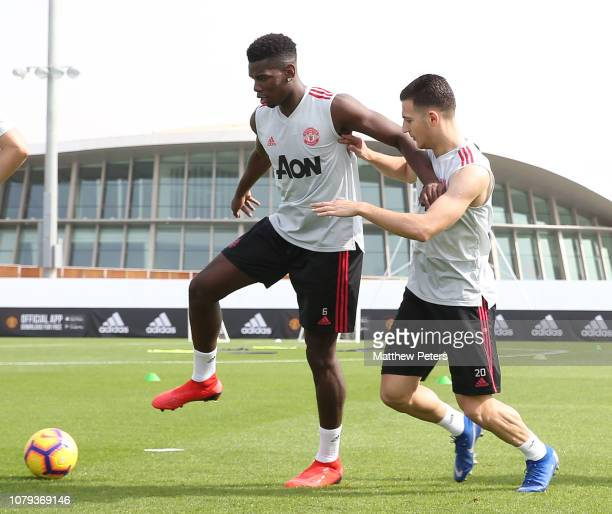 Paul Pogba and Diogo Dalot of Manchester United in action during a first team training session at Nad Al Sheba Sports Complex on January 8 2019 in...