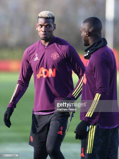 Paul Pogba and Eric Bailly of Manchester United in action during a first team training session ahead of the UEFA Champions League Group H stage match...