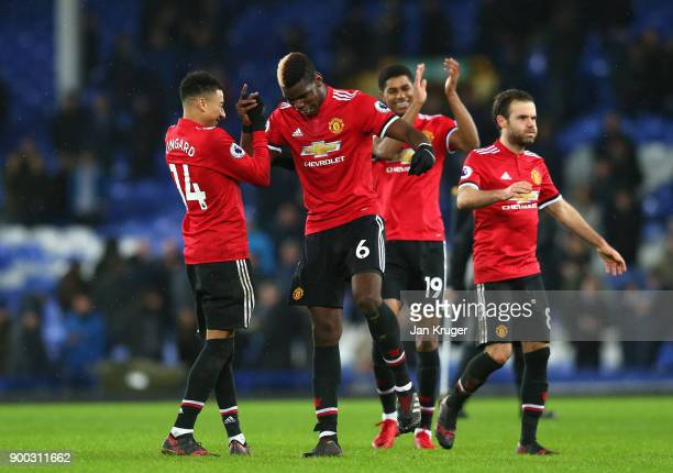 Paul Pogba and Jesse Lingard of Manchester United celebrate victory during the Premier League match between Everton and Manchester United at Goodison...