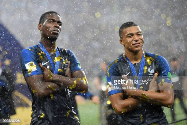 Paul Pogba and Kylian Mbappe of France celebrate victory following the 2018 FIFA World Cup Final between France and Croatia at Luzhniki Stadium on...