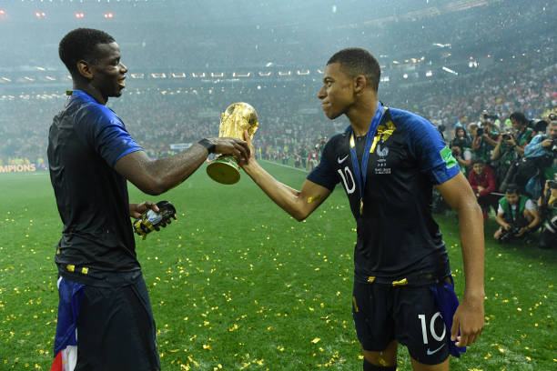 Paul Pogba and Kylian Mbappe of France celebrate victory with the World Cup trophy following the 2018 FIFA World Cup Final between France and Croatia...
