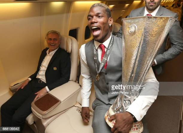 Paul Pogba and Manager Jose Mourinho of Manchester United celebrate with the Europa League trophy on the plane home after the UEFA Europa League...