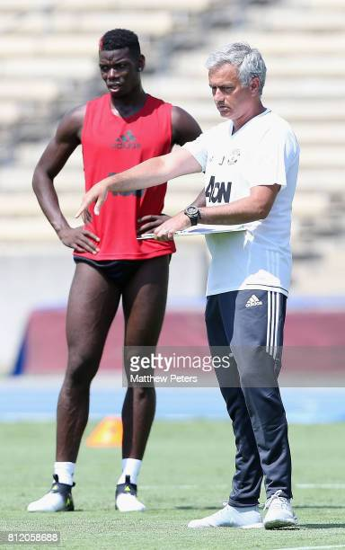 Paul Pogba and Manager Jose Mourinho of Manchester United in action during a first team training session as part of their preseason tour of the...