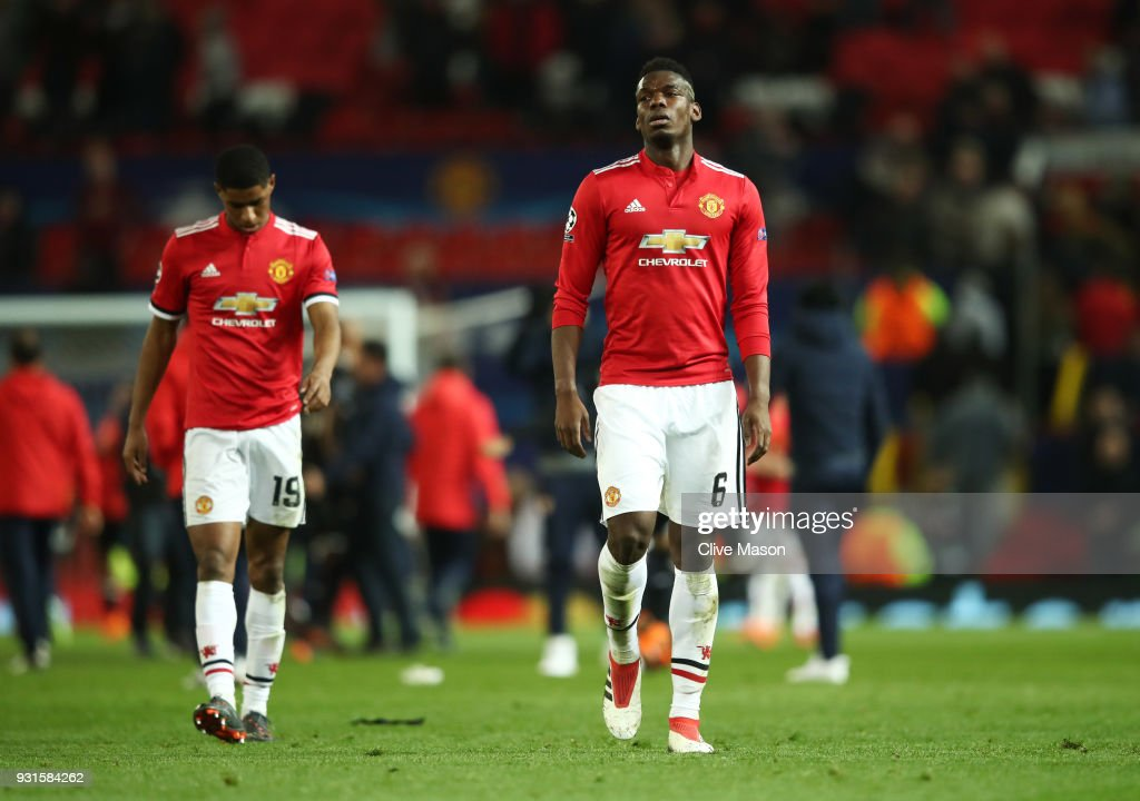 Paul Pogba and Marcus Rashford of Manchester United look dejected in defeat after the UEFA Champions League Round of 16 Second Leg match between Manchester United and Sevilla FC at Old Trafford on March 13, 2018 in Manchester, United Kingdom.
