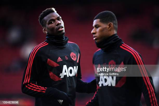 Paul Pogba and Marcus Rashford of Manchester United warms up prior to the Premier League match between Manchester United and Everton FC at Old...