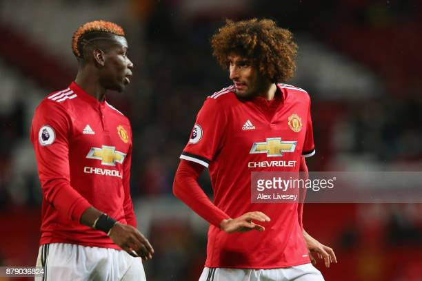 Paul Pogba and Marouane Fellaini of Manchester United speak following the Premier League match between Manchester United and Brighton and Hove Albion...