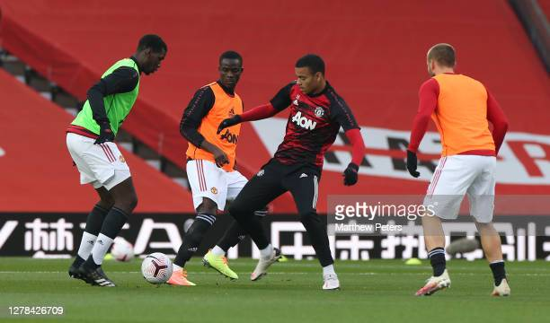 Paul Pogba and Mason Greenwood of Manchester United warms up ahead of the Premier League match between Manchester United and Tottenham Hotspur at Old...