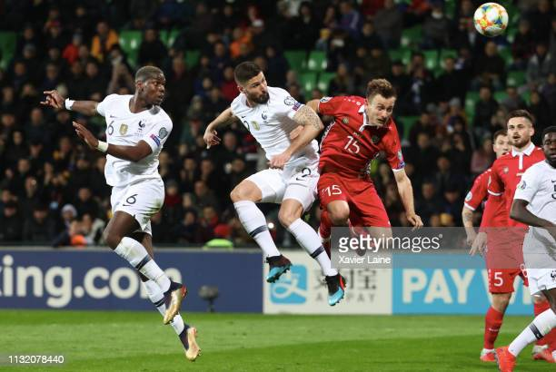 Paul Pogba and Olivier Giroud of France kick the ball ober Ion Jardan of Moldova during the 2020 UEFA European Championships Group H qualifying match...