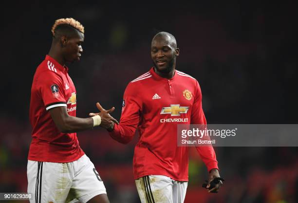 Paul Pogba and Romelu Lukaku of Manchester United celebrate victory after the Emirates FA Cup Third Round match between Manchester United and Derby...