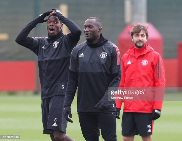 Paul Pogba and Romelu Lukaku of Manchester United in action during a first team training session at Aon Training Complex on November 21 2017 in...