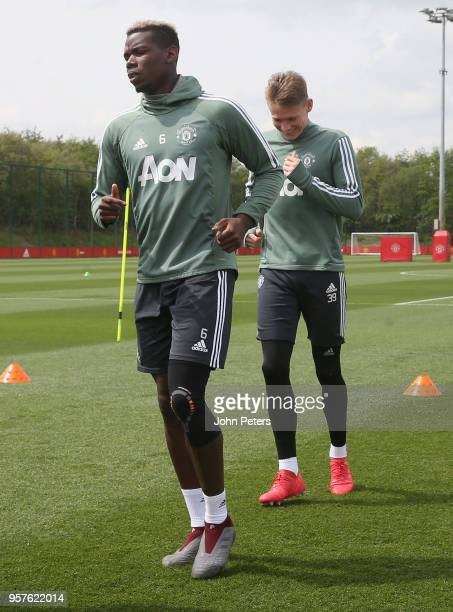 Paul Pogba and Scott McTominay of Manchester United in action during a first team training session at Aon Training Complex on May 12 2018 in...
