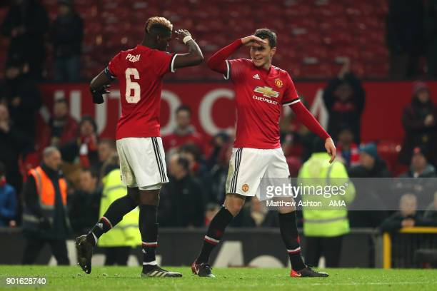 Paul Pogba and Victor Lindelof of Manchester United celebrate at the end of the Emirates FA Cup Third Round match between Manchester United and Derby...