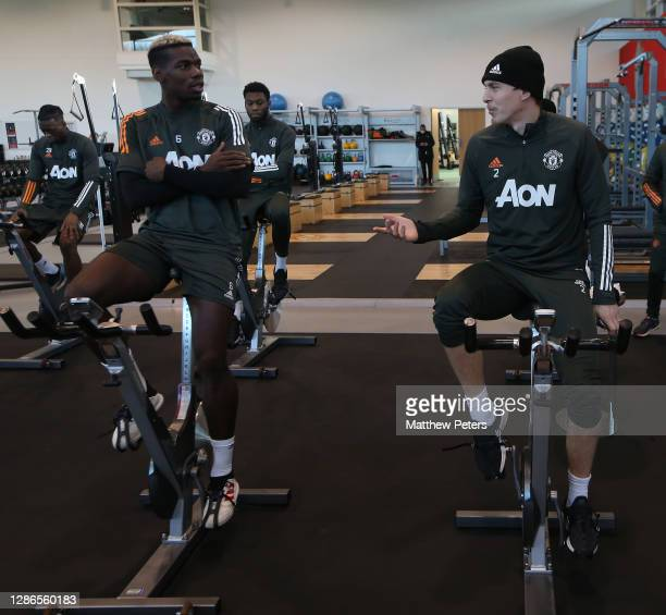 Paul Pogba and Victor Lindelof of Manchester United in action during a first team training session at Aon Training Complex on November 19, 2020 in...