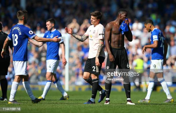 Paul Pogba and Victor Lindelof of Manchester United look dejected following the Premier League match between Everton FC and Manchester United at...