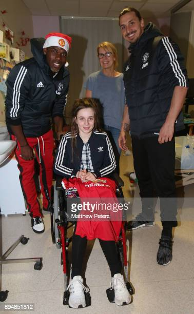 Paul Pogba and Zlatan Ibrahimovic of Manchester United deliver Christmas presents to Hannah during the club's annual Christmas hospital visits at...