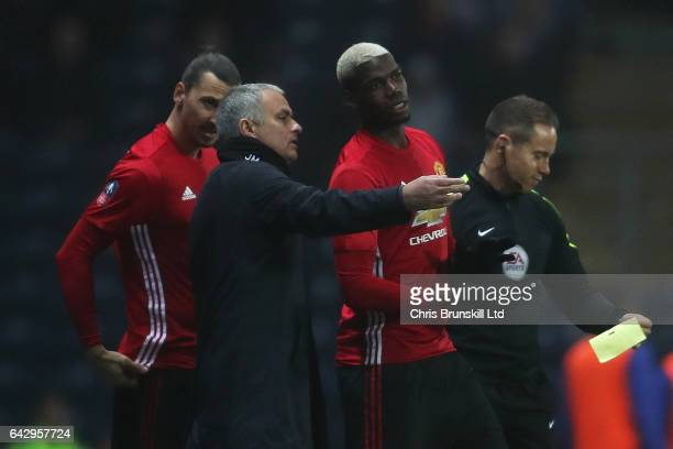Paul Pogba and Zlatan Ibrahimovic of Manchester United prepare to enter the field as substitutes as manager Jose Mourinho gives instructions during...