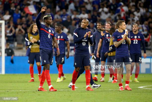 Paul Pogba, Anthony Martial, Lucas Digne of France salute the supporters following the 2022 FIFA World Cup Qualifier match between France and Finland...
