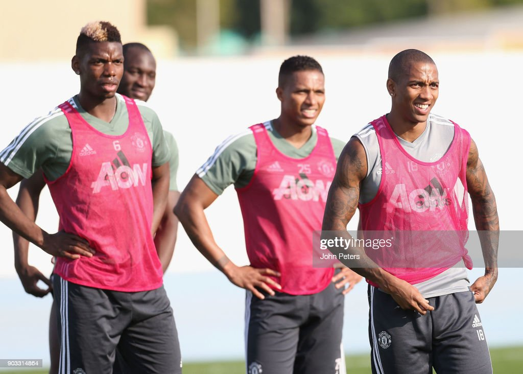 Paul Pogba, Antonio Valencia and Ashley Young of Manchester United in action during a first team training session at Nad Al Sheba Sports Complex on January 10, 2018 in Dubai, United Arab Emirates.