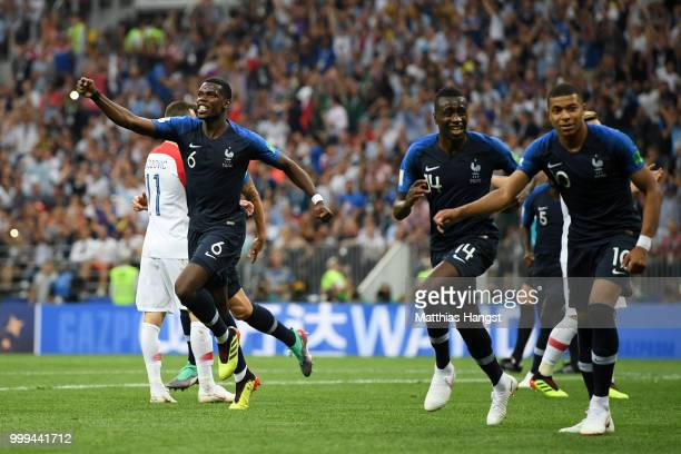 Paul Pogba Blaise Matuidi and Kylian Mbappe of France celebrate their team's first goal an own goal scored by Mario Mandzukic of Croatia during the...