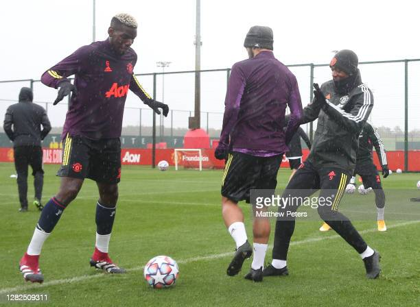Paul Pogba Bruno Fernandes Anthony Martial of Manchester United in action during a first team training session ahead of the UEFA Champions League...