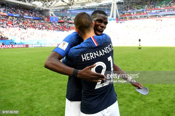 Paul Pogba celebrates with team mate Lucas Hernandez of France following the 2018 FIFA World Cup Russia group C match between France and Australia at...