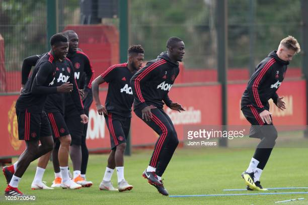 Paul Pogba Fred Eric Bailly and Scott McTominay of Manchester United in action during a first team training session at Aon Training Complex on...