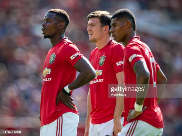 Paul Pogba Harry Maguire and Marcus Rashford of Manchester United during the Premier League match between Manchester United and Crystal Palace at Old...