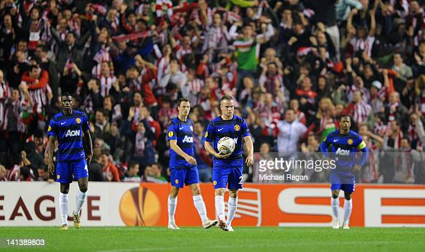 Paul Pogba Jonny Evans Tom Cleverley and Patrice Evra of Manchester United look dejected after the 2nd Bilbao goal during the UEFA Europa League...