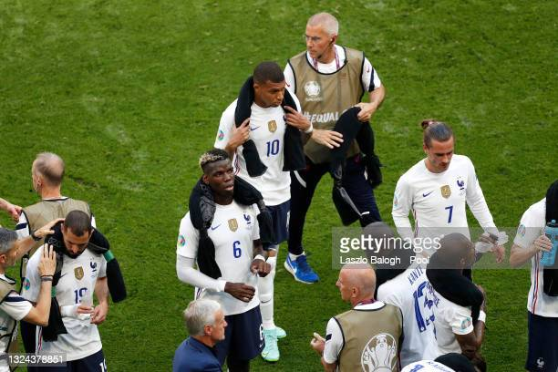 Paul Pogba, Kylian Mbappe and Antoine Griezmann of France look on during the drinks break in the UEFA Euro 2020 Championship Group F match between...