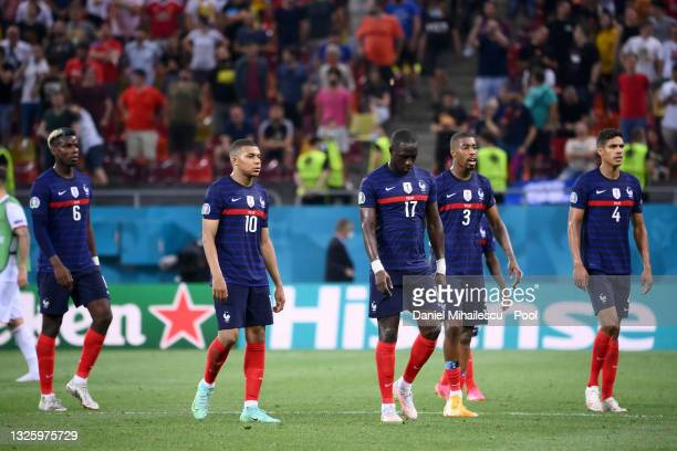 Paul Pogba, Kylian Mbappe, Moussa Sissoko, Presnel Kimpembe and Raphael Varane of France look dejected after the second half of extra time in the...