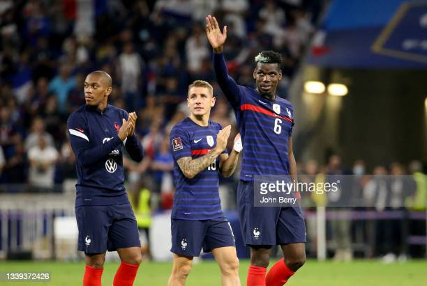 Paul Pogba, left Anthony Martial, Lucas Digne of France salute the supporters following the 2022 FIFA World Cup Qualifier match between France and...