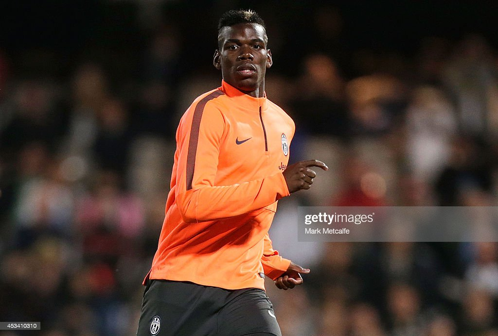 Paul Pogba looks on during a Juventus training session at WIN Jubilee Stadium on August 9, 2014 in Sydney, Australia.