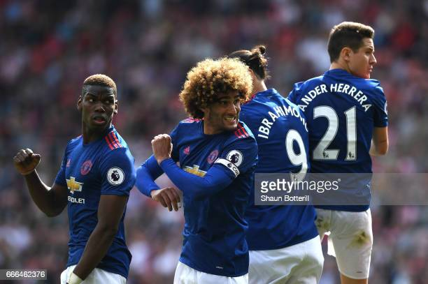 Paul Pogba Marouane Fellaini Zlatan Ibrahimovic and Ander Herrera of Manchester United line up in a wall for a free kick during the Premier League...