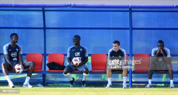 Paul Pogba Ngolo Kante Antoine Griezmann and Blaise Matuidi sit on the bench during a France trainig session on July 12 2018 in Moscow Russia