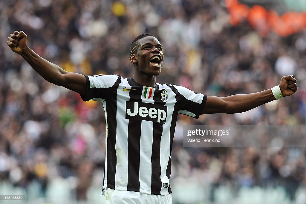 Paul Pogba of FC Juventus celebrates the goal of his team-mates Emanuele Giaccherini during the Serie A match between FC Juventus and Calcio Catania at Juventus Arena on March 10, 2013 in Turin, Italy.