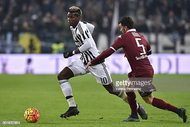 Paul Pogba of FC Juventus in action against Cesare Bovo of Torino FC during the TIM Cup match between FC Juventus and Torino FC at Juventus Arena on...