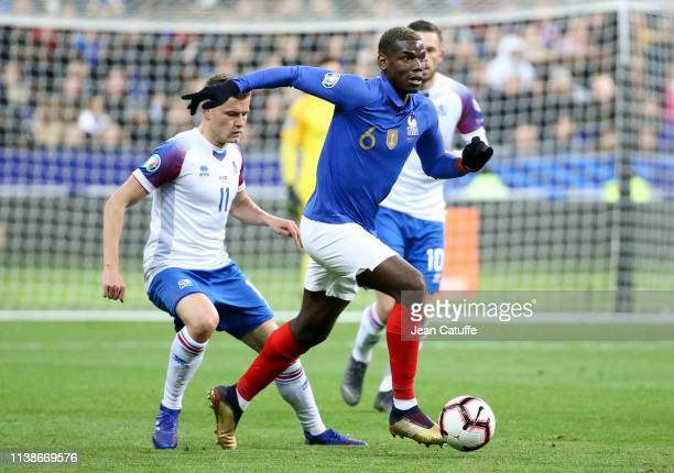Paul Pogba of France, Alfred Finnbogason of Iceland during the 2020 UEFA European Championships group H qualifying match between France and Iceland...