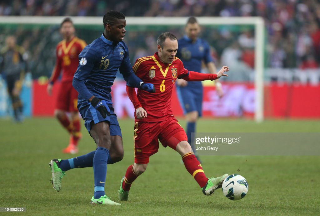 Paul Pogba of France and Andres Iniesta of Spain in action during the FIFA World Cup 2014 qualifier match between France and Spain at the Stade de France on March 26, 2013 in Saint-Denis near Paris, France.