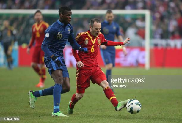 Paul Pogba of France and Andres Iniesta of Spain in action during the FIFA World Cup 2014 qualifier match between France and Spain at the Stade de...