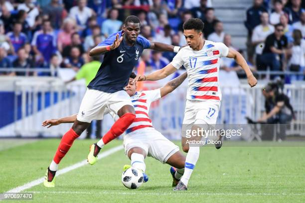 Paul Pogba of France and Antonee Robinson of USA during the International Friendly match between France and United States at Groupama Stadium on June...