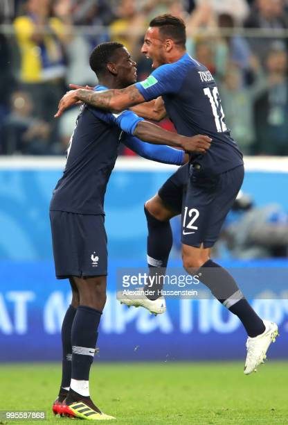Paul Pogba of France and Corentin Tolisso of France celebrate following their sides victory in the 2018 FIFA World Cup Russia Semi Final match...